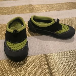 Green and black swim shoes
